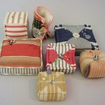 Pin Cushions, made with antique French ticking and stuffed with sawdust from Ned and Nick's workshop.